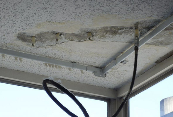 Crack injection is a specialty service of DC Byers. A concrete crack at the corner of a wall foundation.