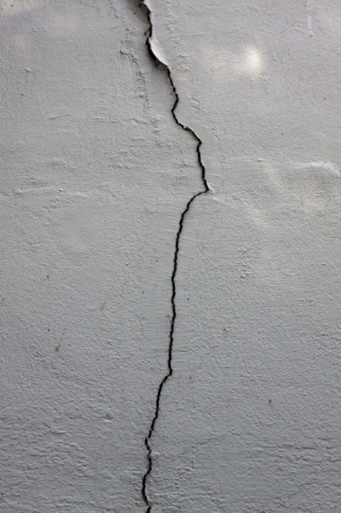 A crack forms along concrete.