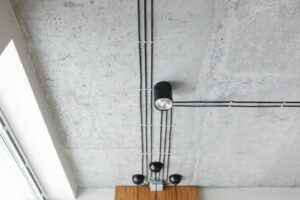 A concrete ceiling with track lighting